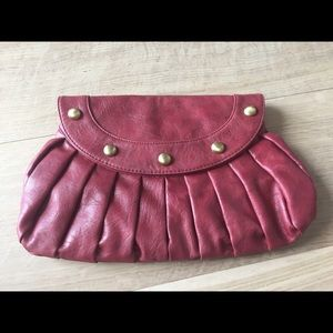 U E cranberry patent leather clutch